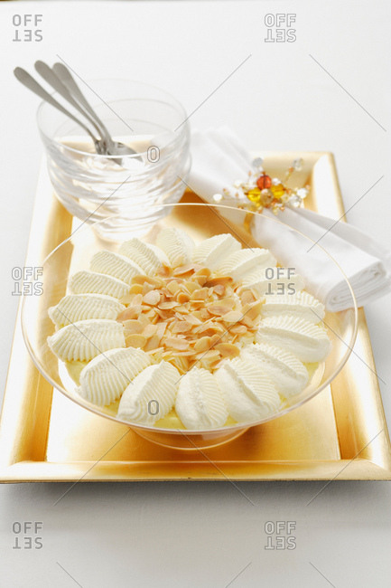 Bowl of custard with nuts and cream