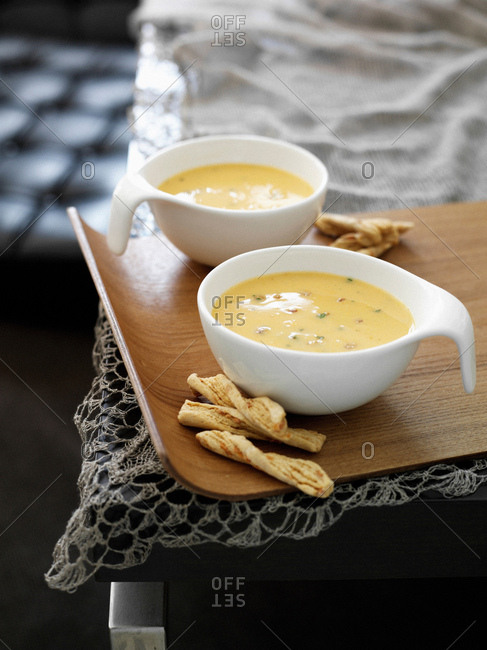 Cup of soup with breadsticks