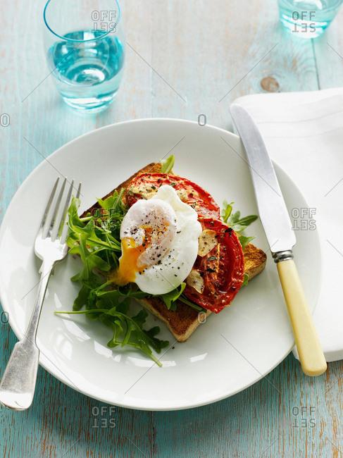 Egg, tomatoes and salad on toast