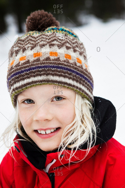 Close up of girls smiling face in snow