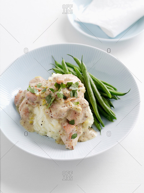 Plate of mashed potatoes and green beans
