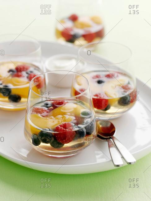 Glasses of fruit salad in gelatin