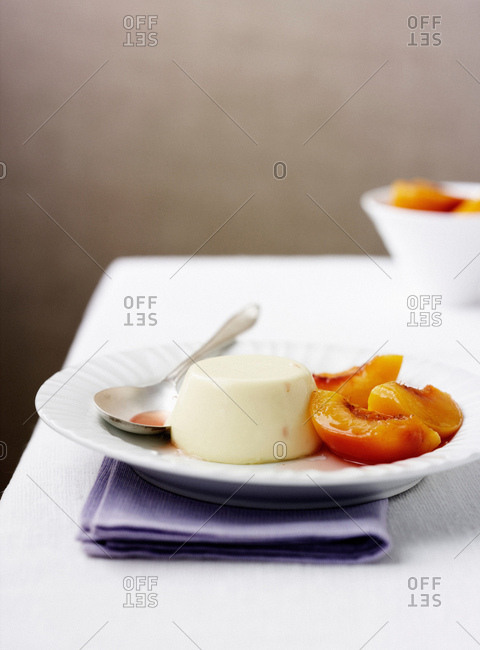 Plate of panna cotta with fruit