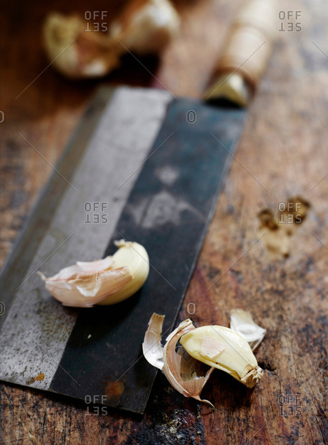 Garlic cloves on butchers knife