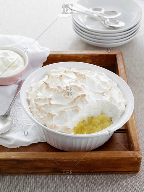 Dish of baked meringue and fruit