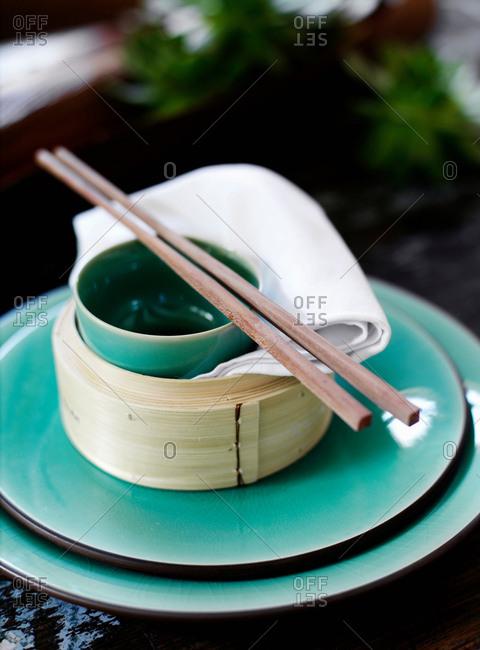 Bowl and chopsticks on rice steamer