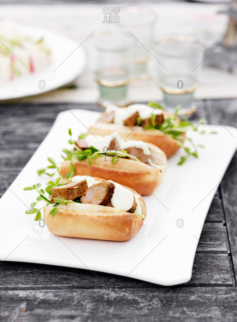 Plate of sandwiches with herbs