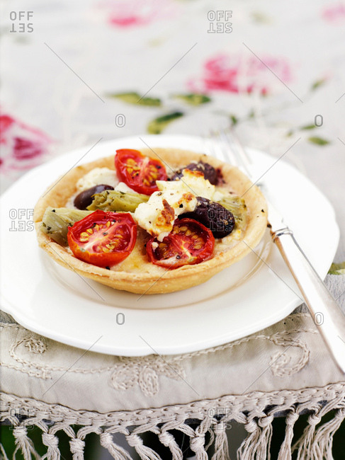 Plate of egg and vegetable quiche