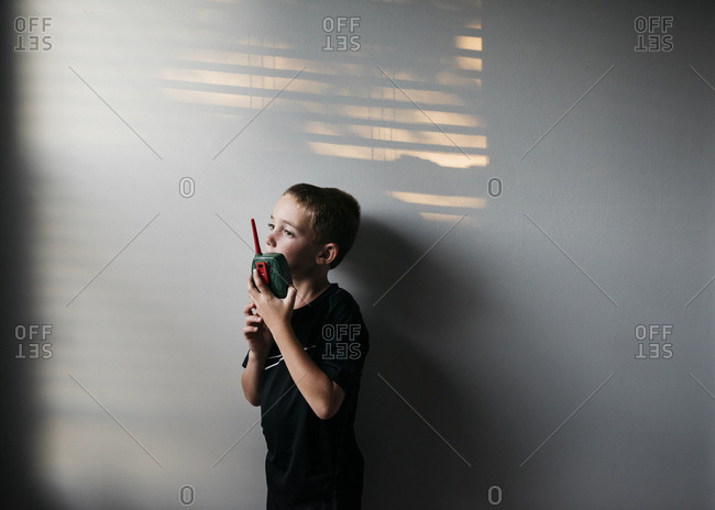 Boy using a walkie talkie
