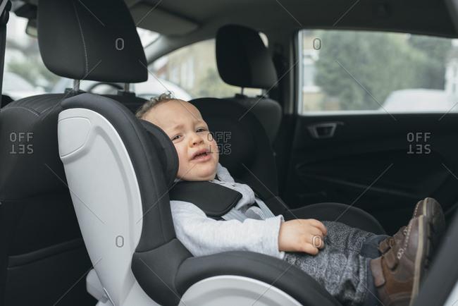 Unhappy baby in rear forward facing car seat