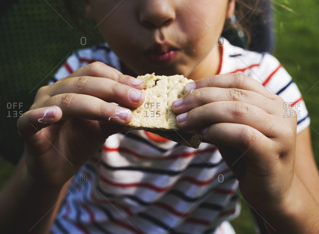 Young girl eating s'more