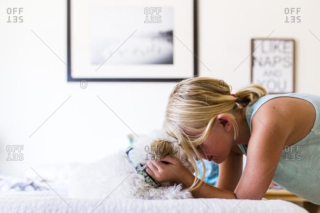 Affectionate girl pets her dog
