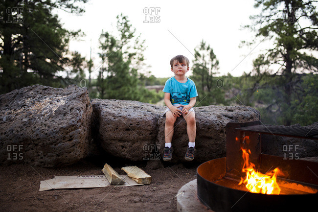 Child sitting on rock at campsite