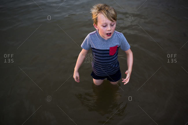 Elevated view of boy standing in water