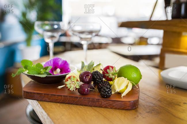 Fresh fruits on wooden cutting board