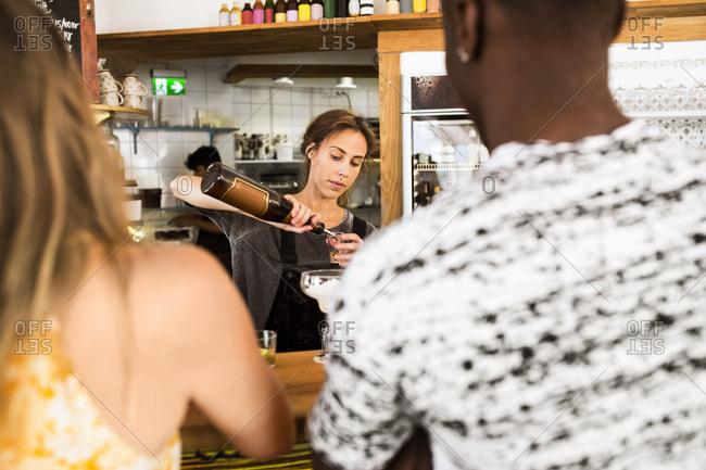 Bartender preparing drinks in restaurant