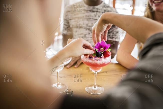 Bartender preparing colorful cocktail