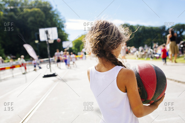 Rear view of girl holding basketball
