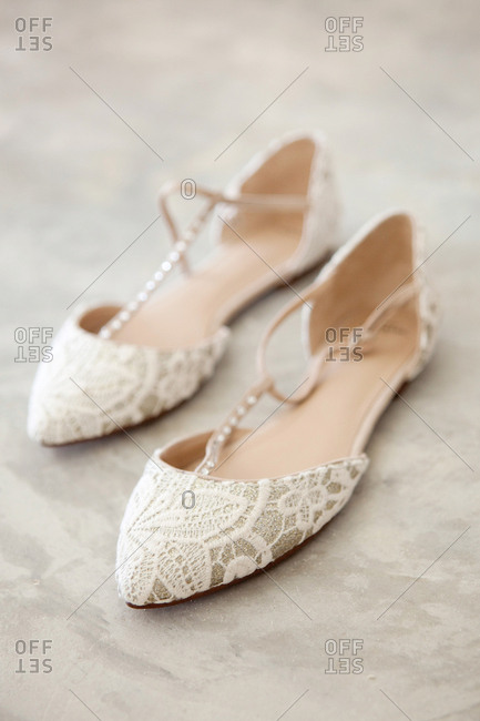 Woman's lace flats with pearl straps