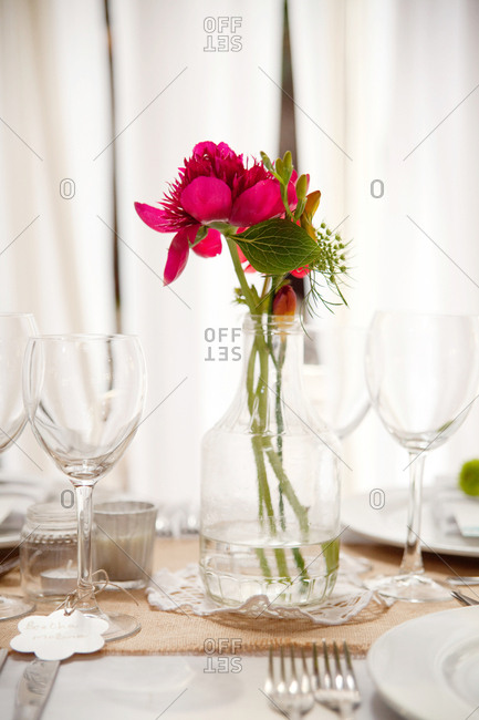 Pink flowers in a jar on an elegant reception table