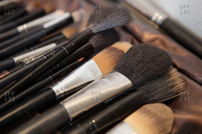 Various make-up brushes in a pile