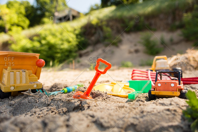 Plastic toys in the sand on a beach