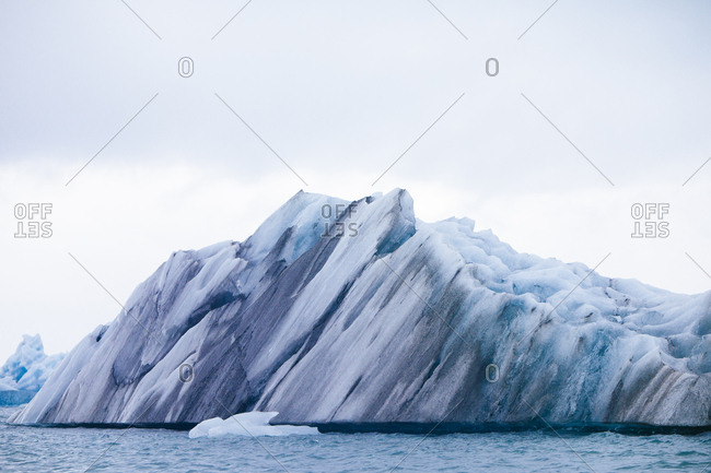 Iceberg with blue and black striations in Jokulsarlon