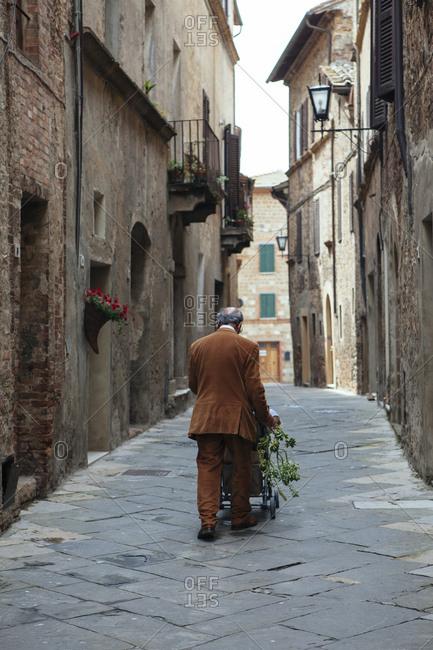 A shopper carts home his groceries