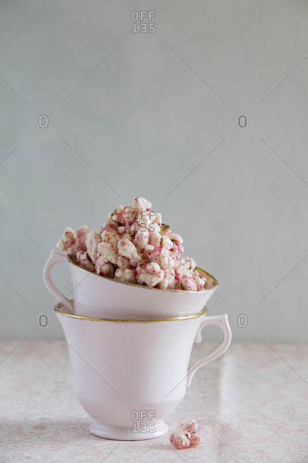 Raspberry popcorn with pink tea cups