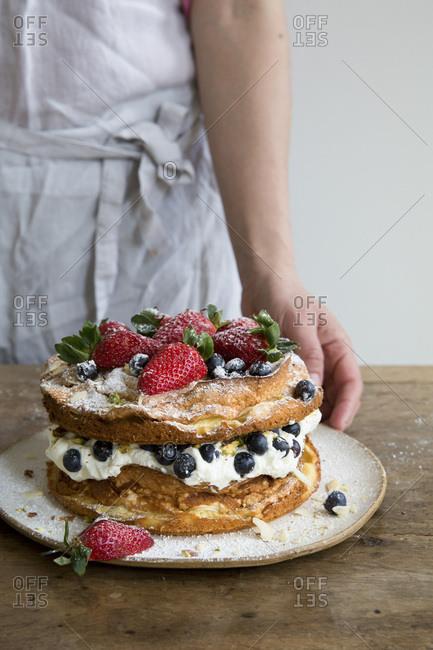 A layered cream sponge and fruit cake