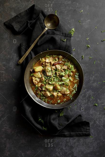 Chicken curry on a dark background