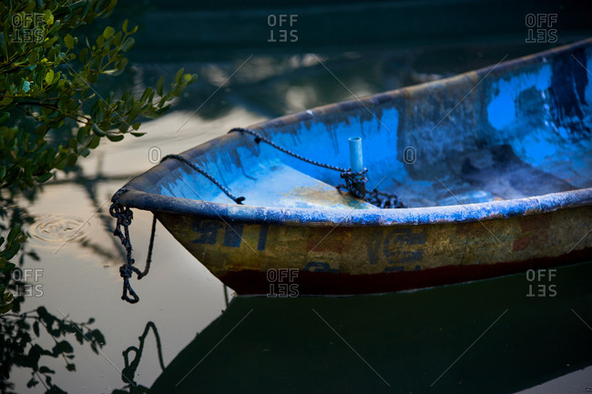 Row boat resting in an inlet