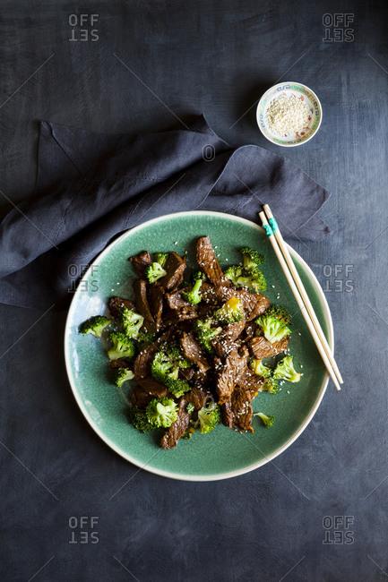 Beef stir fry with broccoli and sesame seeds