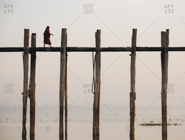 Amarapura, Myanmar - January 20, 2017: View of U-Bein Bridge at dawn, Mandalay Region