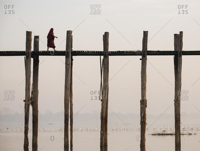 Amarapura, Myanmar - January 20, 2017: View of U-Bein Bridge at dawn, Mandalay Region
