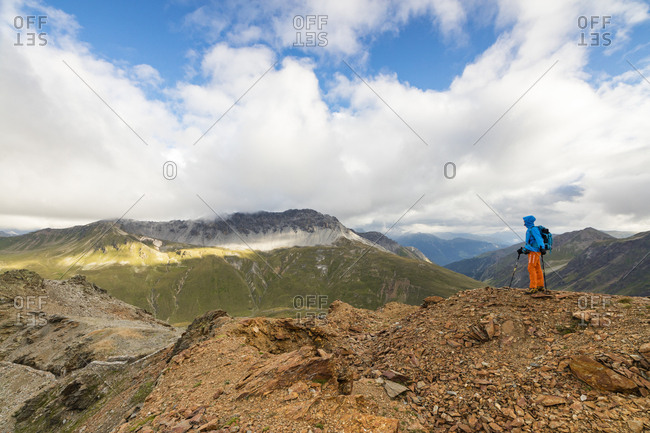 Bormio, Italy - August 11, 2016: Hiker on the war trenches on rocky peaks, Filon Del Mott, Bormio, Braulio Valley, Stelvio Pass, Valtellina, Lombardy, Italy, Europe