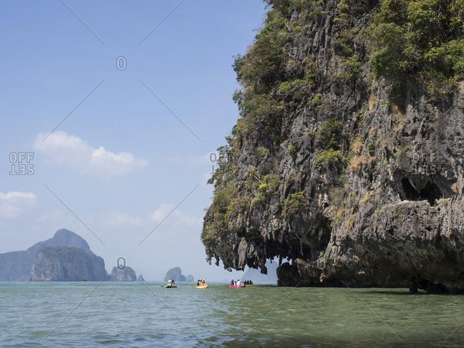 Phang-Nga Bay, Thailand - January 21, 2015: Tourists canoe in Phang-Nga Bay