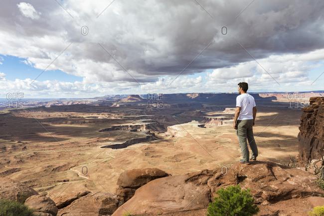 Moab, Utah - September 17, 2015: Man overlooking the landscape in Canyonlands National Park