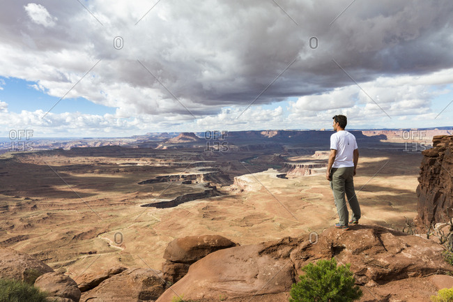 Moab, Utah - September 17, 2015: Man overlooking the landscape in Canyonlands National Park