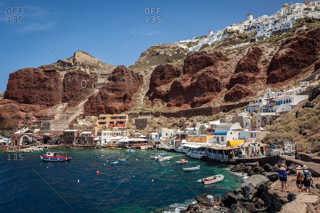 Oia, Greece - June 3, 2016: Ammoudi Bay (Amoudi) at the bottom of the steps below Oia, Santorini, Cyclades, Greek Islands