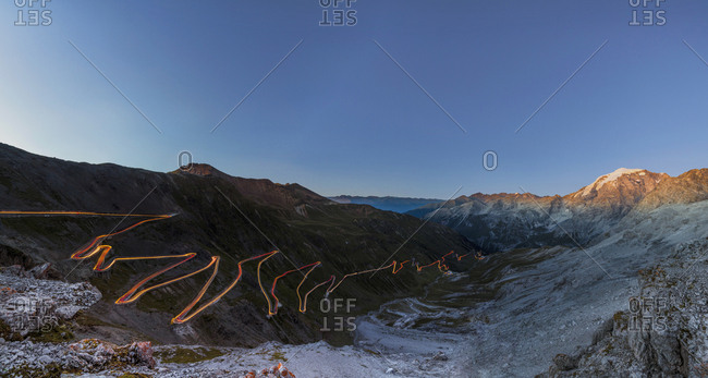 Panorama of lights of car trace at dusk, Stelvio Pass, Valtellina, Lombardy, Trentino Alto Adige, Italy, Europe