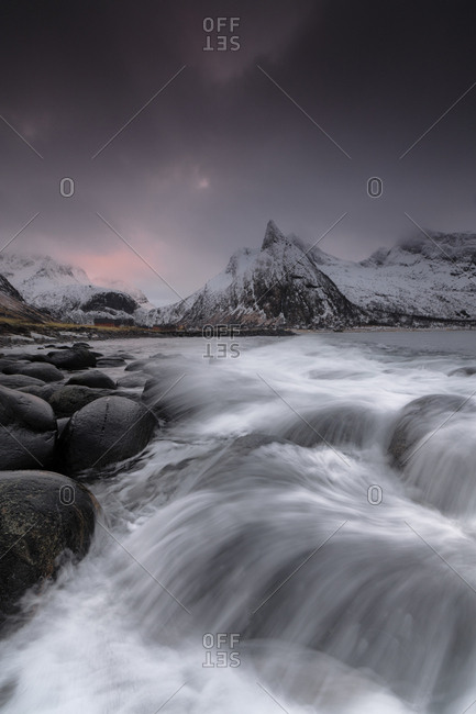 Dark clouds above snowy peaks and waves of the cold sea, Senja, Ersfjord, Troms county, Norway, Scandinavia, Europe