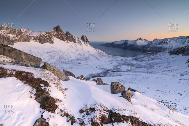 View of the village of Husoy and icy sea along the Oyfjorden from peak Hesten at dawn, Lenvik, Senja, Troms, Norway, Scandinavia, Europe