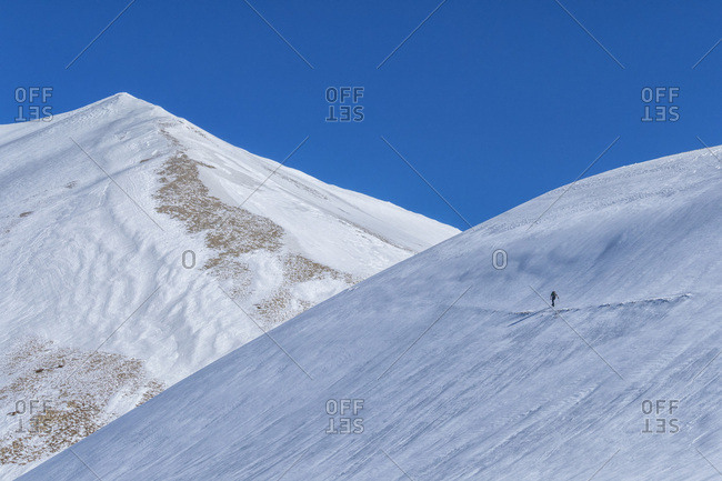 Hiker on mountain Vettore in winter, Sibillini National Park, Umbria, Italy, Europe