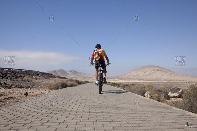 Canary Islands, Spain - April 6, 2017: Fuerteventura- Senior man on mountain bike