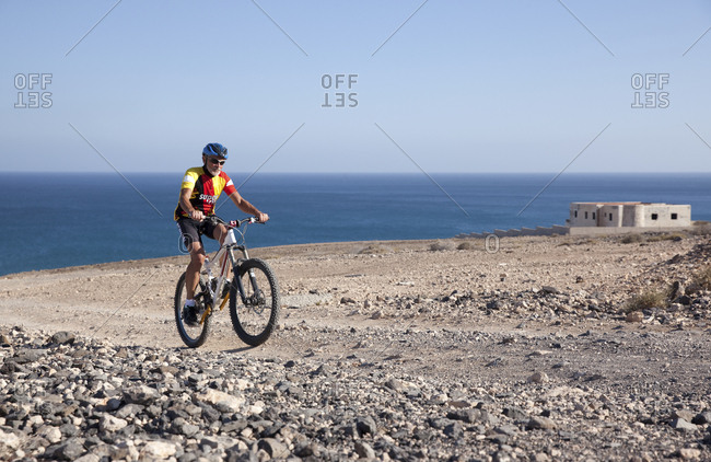 Canary Islands, Spain - April 6, 2017: Fuerteventura- Senior man on mountain bike