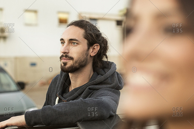 Portrait of bearded young man looking at distance