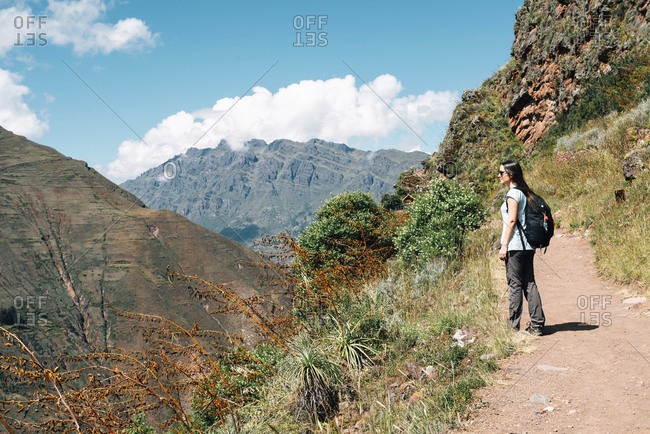 Peru- Valle Sagrado- woman hiking on the way to the Incan ruins of Pisac Archaeological Complex