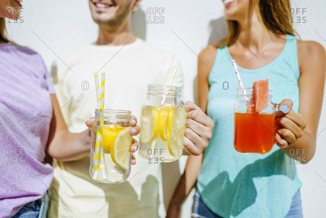Close-up of friends holding refreshing drinks