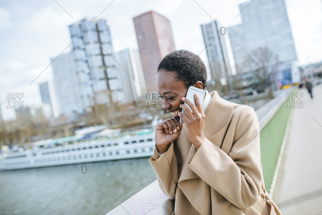 France- Paris-  Young businesswoman talking on the phone